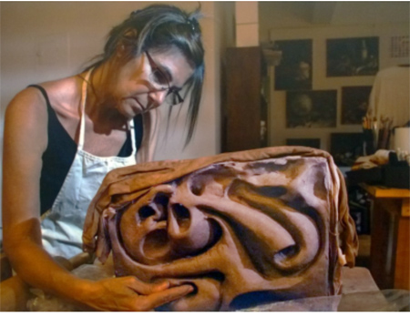 sylvia vigliani working on sculpture